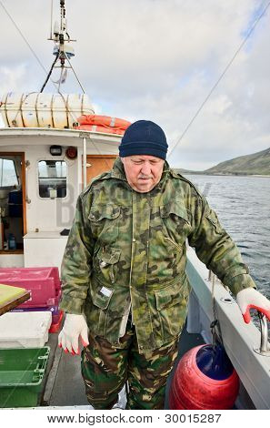 Senior  fisherman on boat (deep sea fishing)