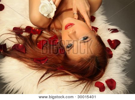 beautiful young woman with roses