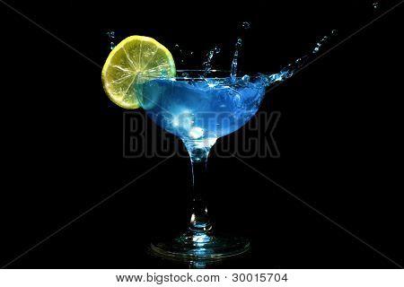 Blue cocktail splash with citron
