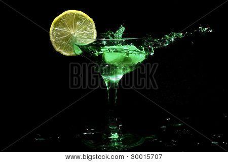 Green cocktail splash with citron