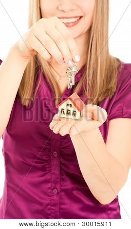 Woman's Hands Holding House And Keys