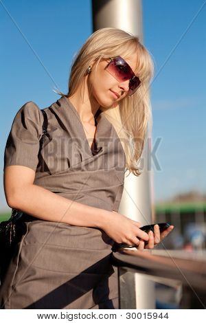 Beautiful Woman In Sunglasses With Cellphone Walking