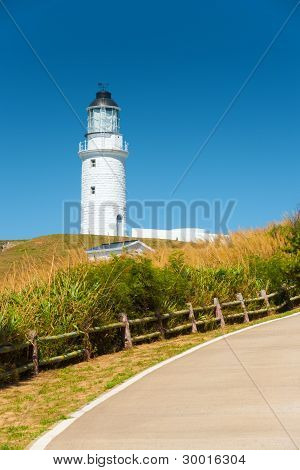 White Lighthouse Curving Country Road
