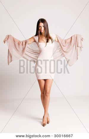 elegant smiling young woman in short dress  studio shot