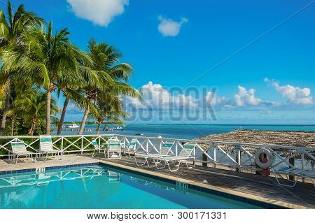 Little Cayman, Cayman Islands, Nov 2018, The Conch Club Swimming Pool With View On The Caribbean Sea