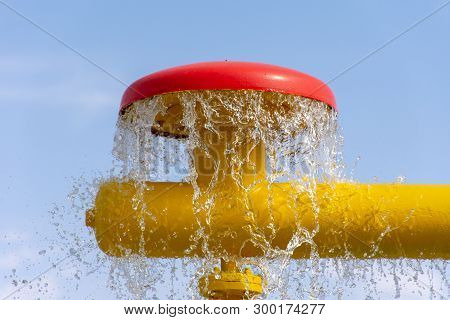 Summertime Fun For The Kids At The Splash Pad To Play With Water Falling From Bright Colored Fountai