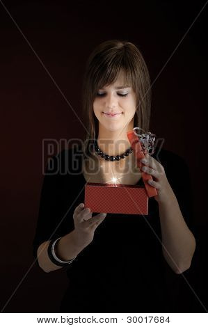 teenager opening a present