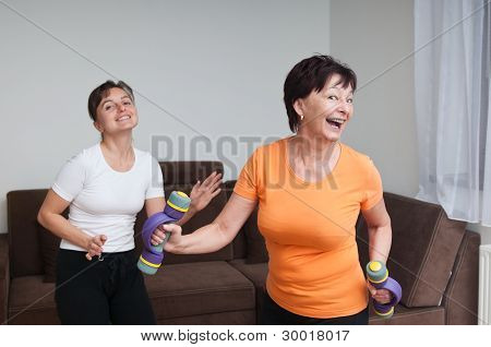 Senior And Young Fitness Woman Dancing