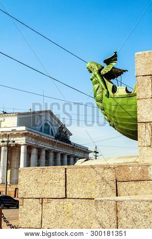 St Petersburg, Russia. Figurehead at the rostral column on the background of Old exchange building in St Petersburg Russia. Landmarks of the Vasilievsky island spit in St Petersburg Russia