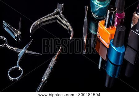 Manicure And Pedicure Tools On Black Background, Isolated. Equipment For Beauty Shop, Cosmetic Salon