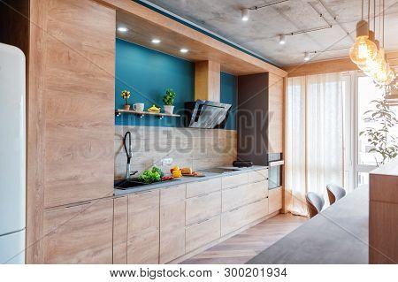 Modern Furniture In Luxury Kitchen. Minimalist Scandinavian Interior In Loft Apartment With Wooden F