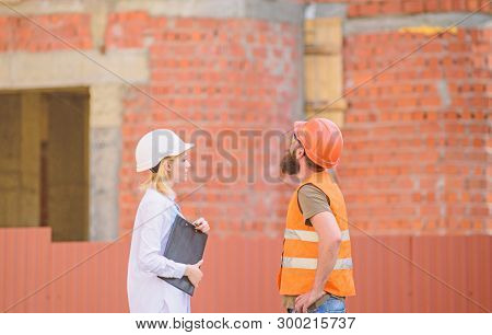 Discuss Progress Project. Construction Industry Concept. Woman Engineer And Bearded Brutal Builder D