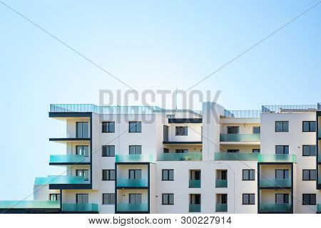 Newly Built Apartments Building On A Bright Blue Sky, With Space For Text On Top. Upper Part Of A Wh