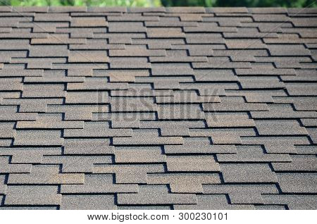 Modern Roofing And Decoration Of Chimneys. Flexible Bitumen Or Slate Shingles