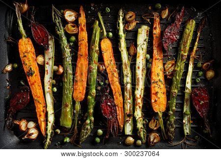 Grilled Vegetables  With The Addition Of Olive Oil, Herbs And Spices  On The Grill Plate, Top View.
