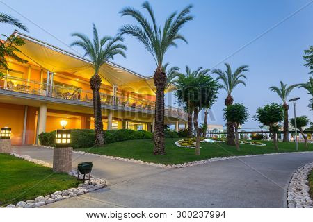 Side, Turkey - June 9, 2018: Beautiful pool area of the TT Pegasos World resort near Side at night, Turkey. Pegasos World Hotel is a 4-star resort with 9600 square metres of pool areas.