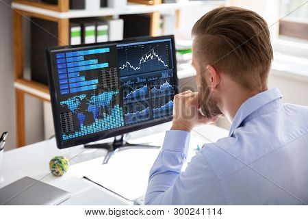 Businessman Looking At Dashboard Analyzing Kpi Graph On Computer