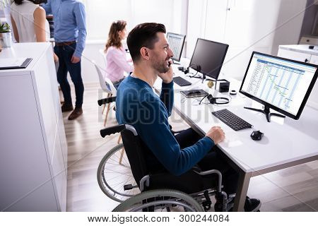 Businessperson Analyzing Gantt Chart On Computer