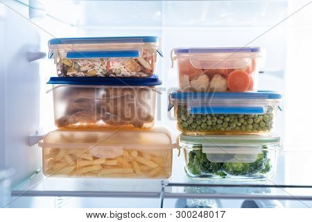 Stacked Of Plastic Containers With Various Food Store In Refrigerator