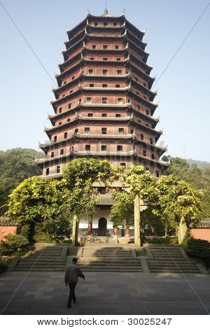 HANGZHOU, CHINA - NOVEMBER 26: Tourist visits the Liuhe Pagoda on November 26, 2011 in Hangzhou, China. It is also known as the Six Harmonies Pagoda and was built in 1165 during the Song Dynasty.