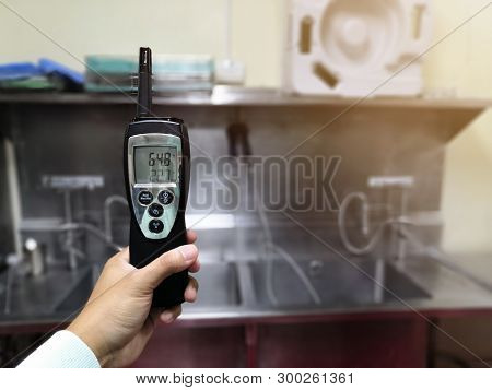 Focus On Technician Checking Temperature And Humidity In Central Sterile Supply Department.cleanroom