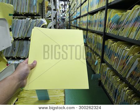 Man Hand Holding Document Control Room In Hospital For Important Documents.abstract.data File. Impor