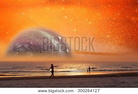 Unreal Landscape Of Dancer Silhouette Dancing On The Beach Of Alien Planet At Sunset. Elements Of Th