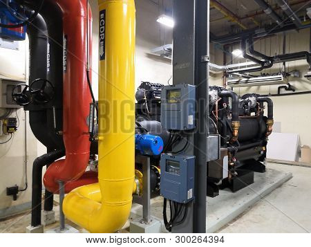 Equipment, Cables And Piping As Found Inside Of Industrial Chiller Plant Room.chiller Room System Fo