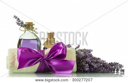 Spa Concept. Lavender Oil, A Soft Towel And Fresh Fragrant Branches Of Lavender Isolated On White Ba