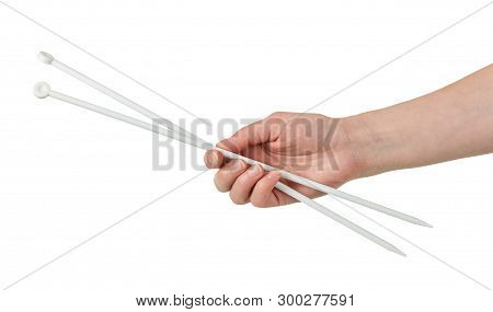 Female Hand With Long Needles For Knitting Isolated On White Background