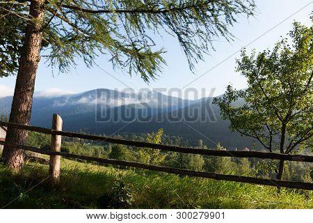 Mountain Summer Village In The Valley. Europe Mountain Village Landscape, Green Valley.