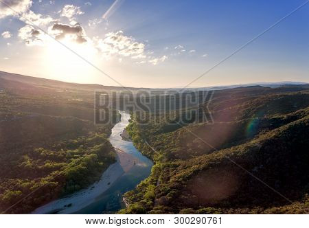 Stunning Aerial Drone Shot Of The Rhone River At Sunrise. The River Reflects The Early Morning Sun A