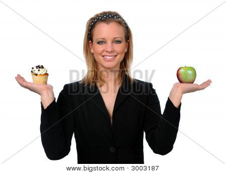 Woman Holding Cup Cake And Apple