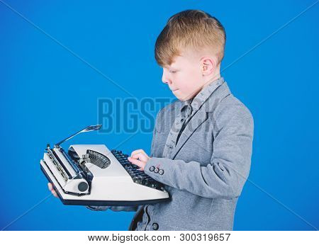 Hes Going To Write A Composition. Smart Child Writer. Little Writer Typing On Retro Typewriter. Cute