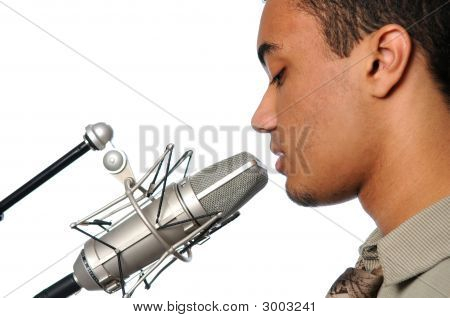 Young Man Singing Into Vintage Microphone