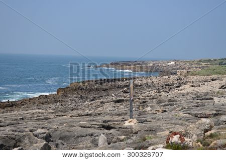Stone Beach Near Fort Of Saint George Of Octaves In Cascais. Photograph Of Street, Nature, Architect