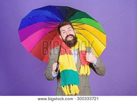 He Likes Rain. Bearded Man Giving Thumbs Up Hand Gesture To Rain Weather. Hipster Holding Colorful U