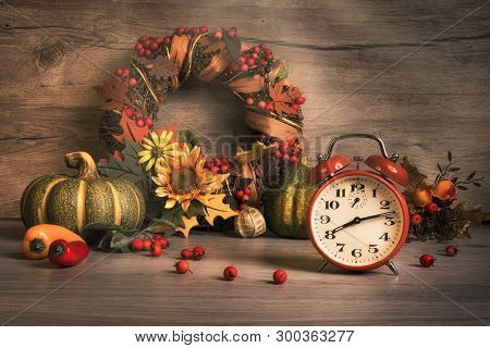 Autumn Still Life With Vintage Alarm Clock, Ornate Wreath With Berries And Ribbons. Design For Your