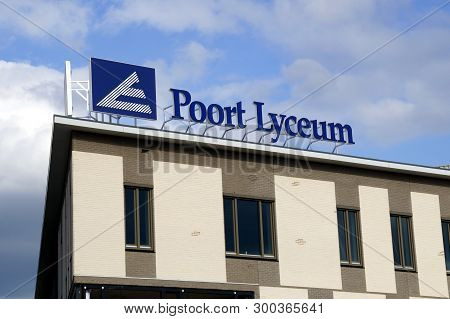 Almere Poort, The Netherlands - May 10, 2019: Roof Logo Of Dutch High School Poort Lyceum In The Cit