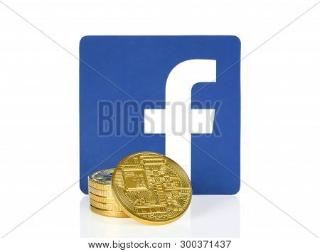 Kiev, Ukraine - April 10, 2019: Facebook Icon Printed On Paper And Placed With Cryptocurrency Coins.