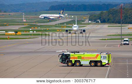 ZURICH - September 08:  Firefighting team of Zurich Airport on duty on September 8, 2018 in Zurich, Switzerland. Zurich airport is home port for Swiss Air and one of the european hubs.