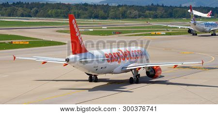 ZURICH - September 08:  Planes preparing for take off at Terminal A of Zurich Airport on September 8, 2018 in Zurich, Switzerland. Zurich airport is home port for Swiss Air and one of european hubs.