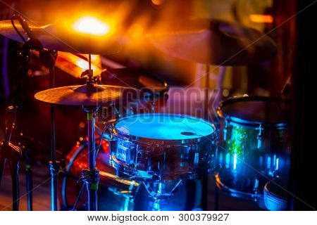 Empty Abstract Light Illuminated Stage With Drumkit And Microphone. Drums In Multicolored Light Duri