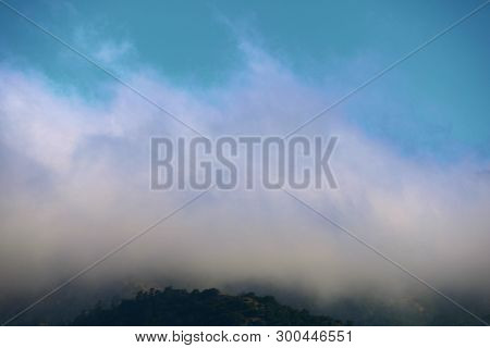 Low Laying Stratus Clouds And Fog Taken On A Hillside In The Coastal California Landscape