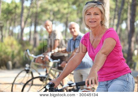 group of seniors riding bikes in the park