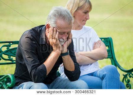 Senior Couple Having Problems In Relationship  At Park Together In Morning Time. Old People Argument