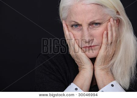Old woman coping with loss