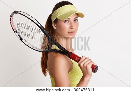 Close Up Portrait Of Beautiful Energetic Strong Tennis Player Looking Directly At Camera, Holding Te