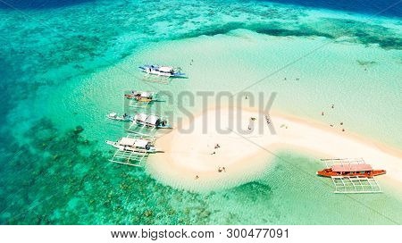 Aerial Seascape Tropical Island With Sand Bar, Turquoise Water And Coral Reef. Ditaytayan, Palawan,