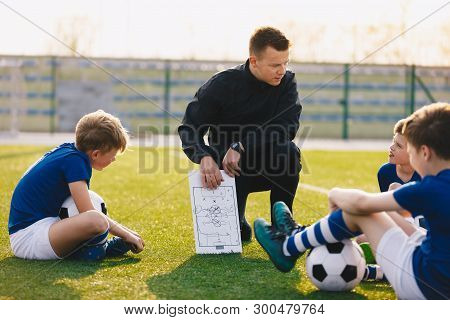 Football Coach Coaching Children. Soccer Football Training Session For Children. Young Coach Teachin